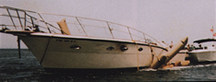 Elongated salvage pontoons used as a lifting sling under the hull